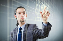 The businessman pressing virtual buttons in futuristic concept Royalty Free Stock Images