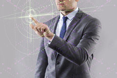 The businessman pressing virtual buttons in futuristic concept. Businessman pressing virtual buttons in futuristic concept Stock Photography