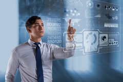 The businessman pressing virtual buttons in futuristic concept. Businessman pressing virtual buttons in futuristic concept Royalty Free Stock Photography