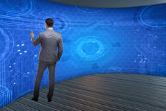 The businessman pressing virtual buttons in futuristic concept. Businessman pressing virtual buttons in futuristic concept Royalty Free Stock Image