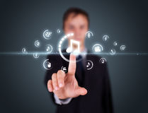 Businessman pressing virtual media type of buttons Stock Photography