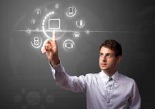 Businessman pressing virtual media type of buttons Stock Photos