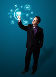 Businessman pressing virtual messaging type of icons Stock Photo
