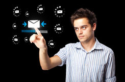 Businessman pressing virtual messaging type of icons Royalty Free Stock Images