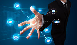 Businessman pressing virtual messaging type of icons Stock Photos