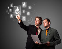Businessman pressing virtual promotion and shipping type of icon Royalty Free Stock Photo