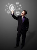 Businessman pressing virtual promotion and shipping type of icon Stock Photo