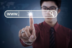 Businessman pressing virtual search button Royalty Free Stock Image