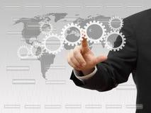 Businessman pressing virtual sprockets. technology and innovatio Royalty Free Stock Photo