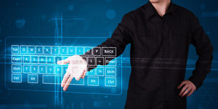 Businessman pressing virtual type of keyboard Royalty Free Stock Photos