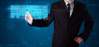 Businessman pressing virtual type of keyboard Stock Image
