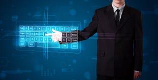Businessman pressing virtual type of keyboard. Young businessman pressing virtual type of keyboard Royalty Free Stock Photos