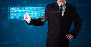 Businessman pressing virtual type of keyboard. Young businessman pressing virtual type of keyboard Stock Image