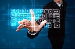 Businessman pressing virtual type of keyboard. Young businessman pressing virtual type of keyboard Royalty Free Stock Image