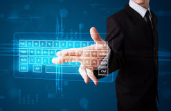 Businessman pressing virtual type of keyboard Royalty Free Stock Photo