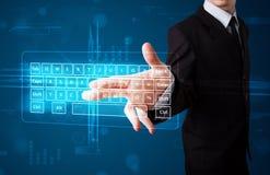 Businessman pressing virtual type of keyboard. Young businessman pressing virtual type of keyboard Royalty Free Stock Photo