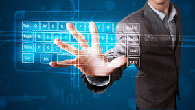Businessman pressing virtual type of keyboard Stock Photo