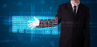 Businessman pressing virtual type of keyboard. Young businessman pressing virtual type of keyboard Stock Photos
