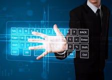 Businessman pressing virtual type of keyboard. Young businessman pressing virtual type of keyboard Stock Images