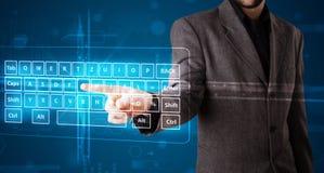 Businessman pressing virtual type of keyboard. Young businessman pressing virtual type of keyboard Stock Photography