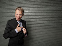 Businessman with a pretend gun Royalty Free Stock Photos