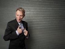 Businessman with a pretend gun Royalty Free Stock Photos