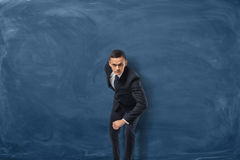 Businessman pretending ready to run his goal on the blue chalkboard background Stock Photos