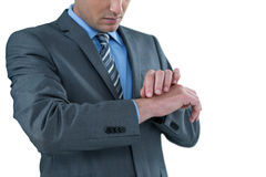 Businessman pretending to check wrist watch Stock Photography
