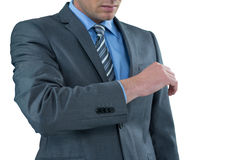 Businessman pretending to check wrist watch Royalty Free Stock Image