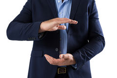 Businessman pretending to hold something Royalty Free Stock Photo
