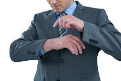 Businessman pretending to use a wrist watch Royalty Free Stock Photography