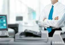 Businessman With Printer In Office Stock Photo