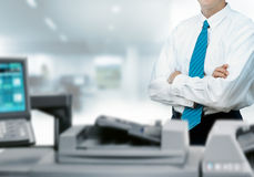 Businessman With Printer In Office Stock Images