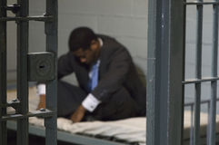Businessman in prison cell Royalty Free Stock Image