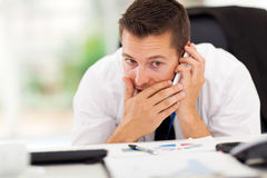 Businessman private call. Businessman taking a private call during working hour Stock Photo