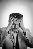 Businessman&problems. Businessman has some problem. BW royalty free stock photo