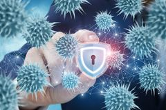 Businessman produces protection against viruses on the network. The businessman produces protection against viruses on the network Stock Photo