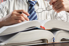 Businessman or professor reading journal Royalty Free Stock Photo