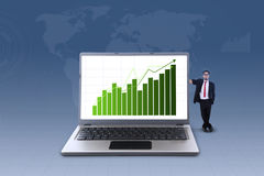 Businessman and profit bar chart on laptop Royalty Free Stock Images