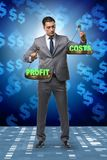 The businessman in profit benefit balance concept. Businessman in profit benefit balance concept royalty free stock images