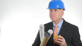 Businessman with Projects Wearing Suit and Helmet Eat Starved a Tasty Snack.  royalty free stock photos