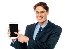 Businessman promoting newly launched tablet Royalty Free Stock Images