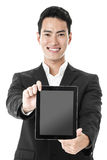 Businessman promoting tablet Stock Photography