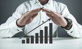 Businessman protect financial growth chart. Investment concept stock photo