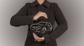 Businessman protect hand drawn of silhouette of car Stock Photography