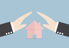 Businessman protect house by hands Royalty Free Stock Photography