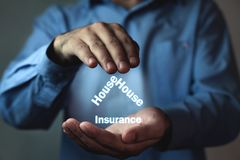 Businessman protect house insurance words. House insurance conce. Pt Stock Images