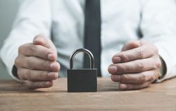 Businessman protect padlock. Security concept Royalty Free Stock Image