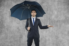 Businessman protect your home Royalty Free Stock Photography