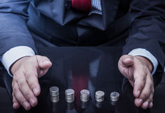 Businessman protected money coins Stock Images